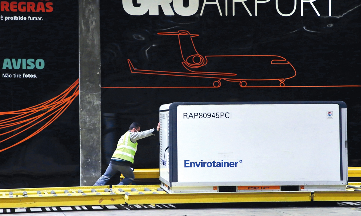 The cargo shipment of COVID-19 vaccines produced by the Chinese company Sinovac Biotech is being dispatched at the Cumbica airport in Guarulhos, Sao Paulo state, Brazil, on July 20. Photo: AFP