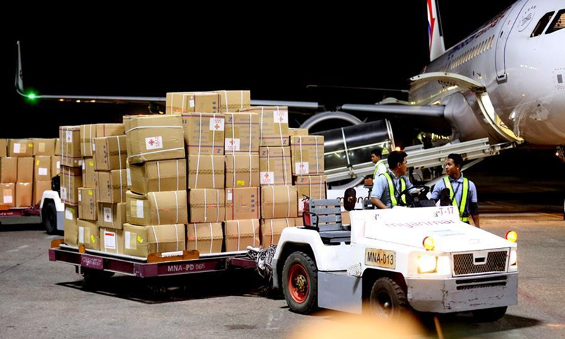 Workers unload protective equipment donated by Chinese government at the Yangon International Airport in Yangon, Myanmar, March 27, 2020.File photo:Xinhua