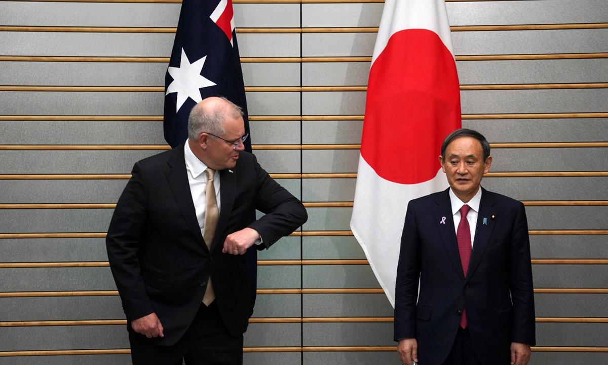 Japanese Prime Minister Yoshihide Suga met visiting Australian Prime Minister Scott Morrison on Tuesday. Photo: AFP