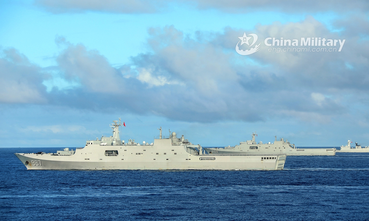 The amphibious dock landing ships Wuzhishan (Hull 987), Kunlunshan (Hull 998) and Changbaishan (Hull 989) attached to a landing ship flotilla with the navy under the PLA Southern Theater Command steam alongside in waters of the South China Sea during a maritime training exercise on November 18, 2020. The exercise lasted four days, focusing on 10 subjects including comprehensive defense, Landing Craft Air Cushion's (LCAC) transfer, visit, board, search and seizure (VBSS) operation, and live-fire operations. (eng.chinamil.com.cn/Photo by Liu Jian)