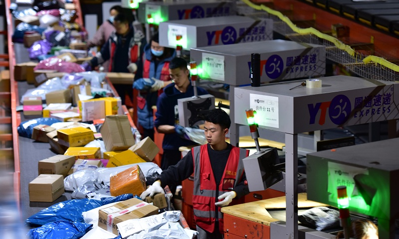 Employees of YTO Express sort packages at a distribution center in southwest China's Guizhou Province on November 11. Photo: IC