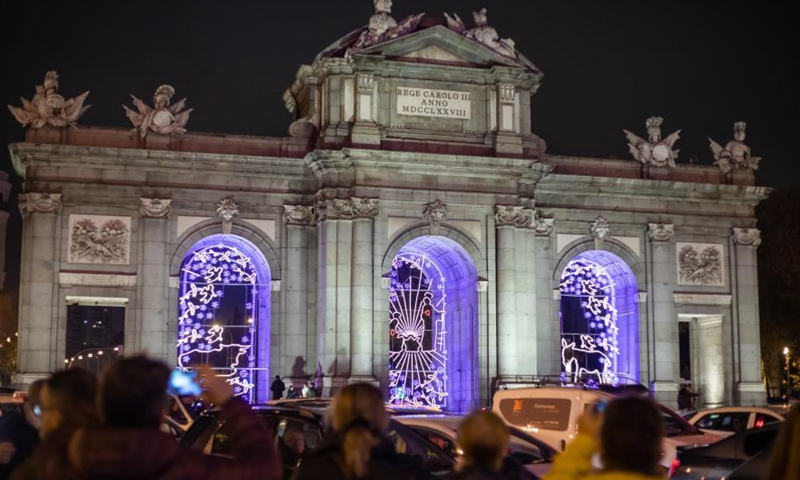 Alcala Gate is decorated with festive lights in Madrid, capital of Spain, Nov. 28, 2020. The festive lights for Christmas were displayed from Nov. 26, 2020 and will last till Jan. 6, 2021. (Xinhua/Meng Dingbo)