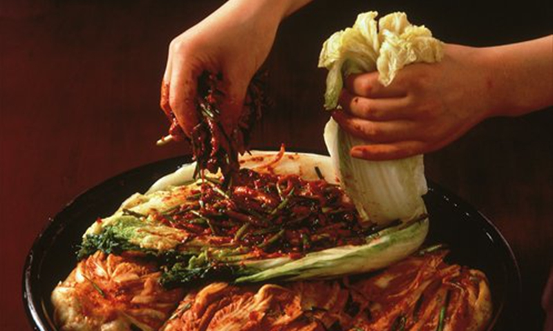 A person making kimchi Photo: CFP