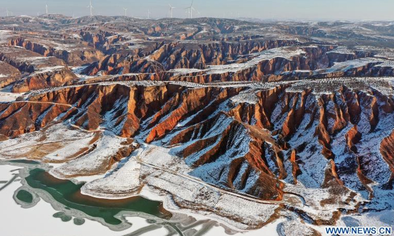 Aerial photo taken on Dec. 3, 2020 shows a view of the Mahuangliang Loess Geopark after snow in Yulin City, northwest China's Shaanxi Province.Photo:Xinhua