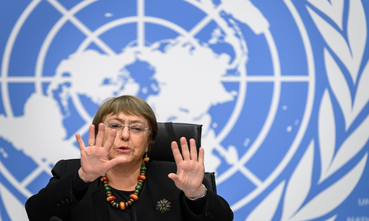 UN High Commissioner for Human Rights Michelle Bachelet gestures at a press conference on Wednesday in Geneva. The UN human rights chief warned that the coronavirus crisis had