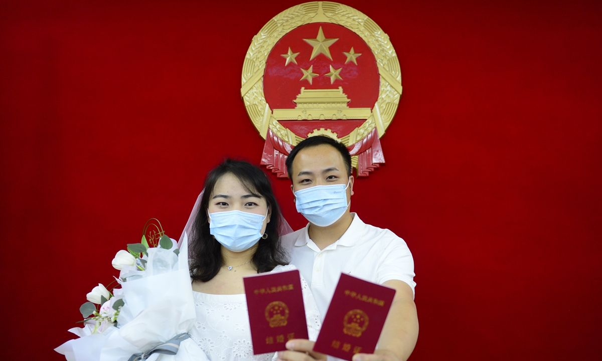 Chinese band Mayday based on the island of Taiwan livestream a concert Photo: Courtesy of TME Live   A girl is jogging with a mask.    A waitress showcases the serving chopsticks in East China's Jiangsu Province.  A newly wedded couple showcase their marriage certificates. Photos: IC, VCG
