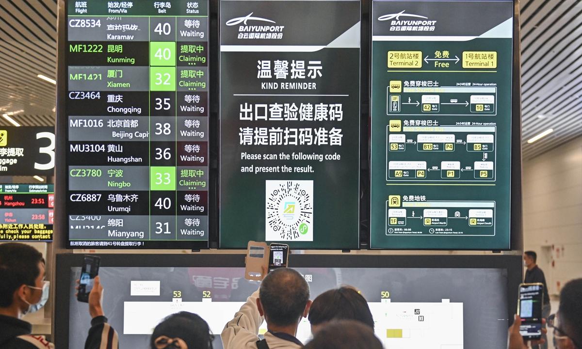 Passengers scan health code at Guangzhou Baiyun International Airport after landing in October. Photo: cnsphoto