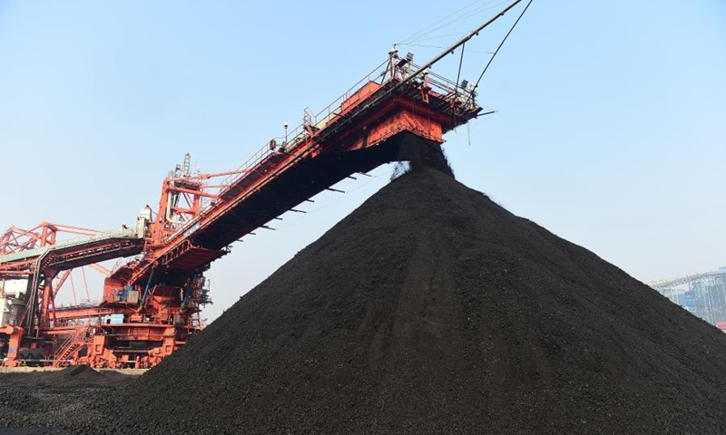 Photo taken on Dec. 22, 2020 shows a thermal coal yard of Huanghua Port in Cangzhou City, north China's Hebei Province. Huanghua Port, one of the key ports for thermal coal transportation in China, has stepped up its turnover rate since this December. A daily average of 500,000 tonnes of thermal coal is loaded to ships at the port now to quench the thirst for coal-fired power generation in southern parts of the country. (Xinhua/Wang Min)