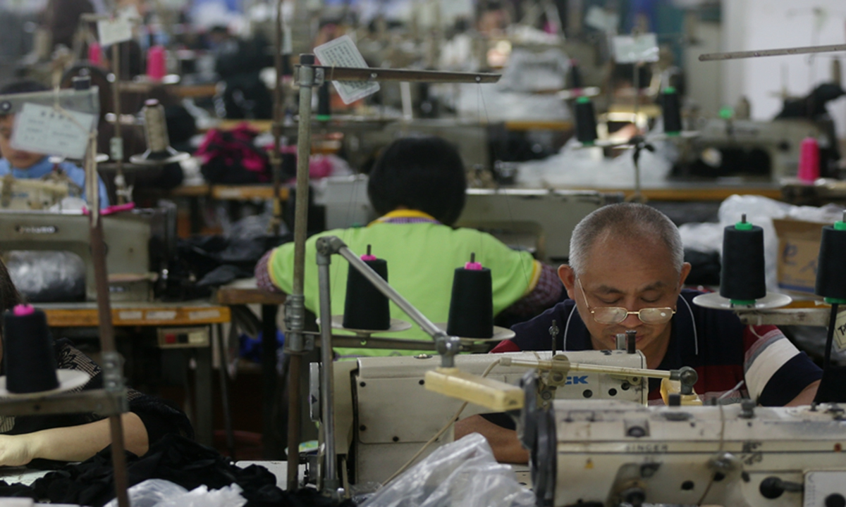 Workers make linen products inside a textile plant in Dongguan, South China's Guangdong Province.  Photo: GT/Cui Meng