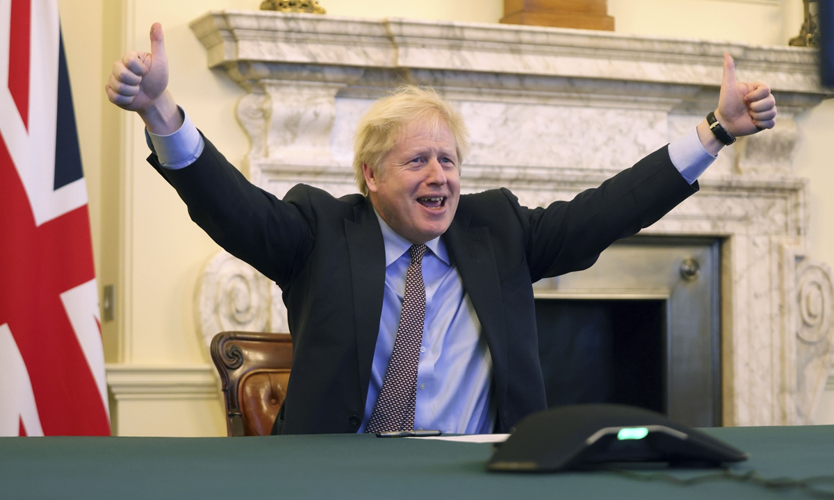 British Prime Minister Boris Johnson celebrates the agreement between the UK and the EU at his office in London on Thursday. Britain said on the same day that an agreement had been secured on the country's future relationship with the European Union, after last-gasp talks just days before a cliff-edge deadline. Photo: Xinhua