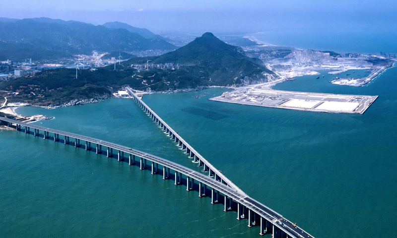 An aerial photo shows the Pingtan Strait Road-rail Bridge in East China's Fujian Province. The first of its kind in China, the bridge opened on Saturday, shortening travel time between the provincial capital of Fuzhou with the island county of Pingtan to 35 minutes from around two hours. The bridge will make it more convenient for compatriots in the island of Taiwan to travel to the Chinese mainland. Photo: cnsphoto