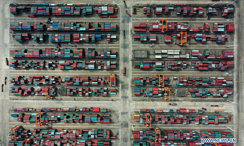 Aerial photo taken on Nov. 19, 2020 shows containers piled at the Qinzhou Port in south China's Guangxi Zhuang Autonomous Region. The five millionth twenty-foot equivalent unit (TEU) containers in 2020 was handled at the Qinzhou Port area of the Beibu Gulf Port on Monday, marking the Beibu Gulf Port's container throughput reaching 5 million TEUs this year. The Beibu Gulf Port currently has 268 berths for commercial vessels. A total of 52 shipping routes link the gulf with many ports both at home and abroad, including major ASEAN ports, according to the Beibu Gulf Port Group. (Xinhua/Zhang Ailin)