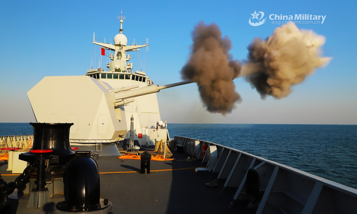 The guided-missile destroyer Qiqihar (Hull 121) attached to the navy under the PLA Northern Theater Command fires its main gun at mock sea targets during a maritime live-fire training exercise in mid December, 2020. (eng.chinamil.com.cn/Photo by Zhang Hailong)