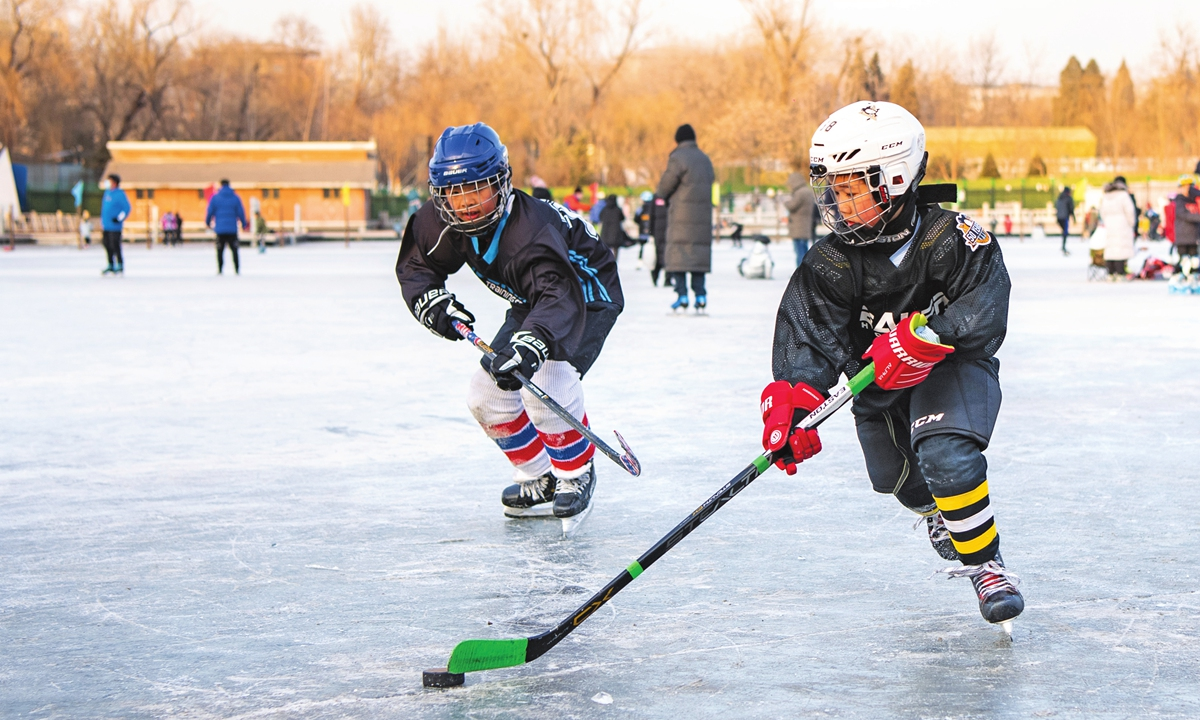 Children play ice hockey on the frozen lake in Yuyuantan Park in Beijing on Sunday, the last day of the New Year holidays. Winter sports are getting more popular in China, and the capital will hold the 2022 Winter Olympic Games. Photo: cnsphoto