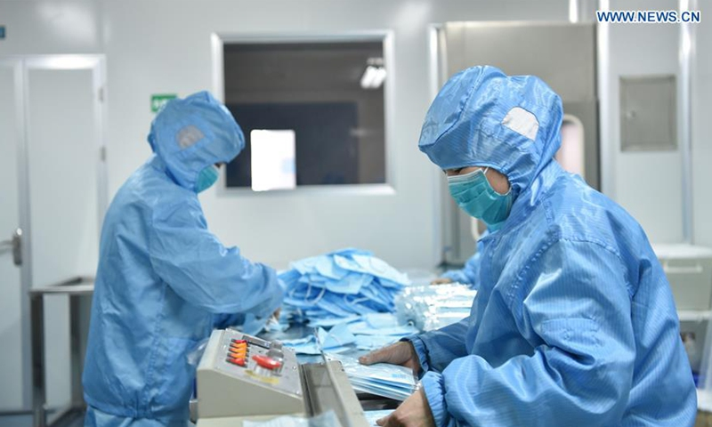 Workers make face masks at the workshop of a face mask company in Dingzhou,north China's Hebei Province, Feb. 18, 2020.File photo:Xinhua