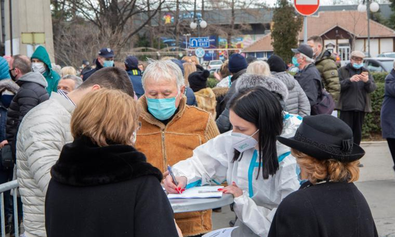 People get registered to receive COVID-19 vaccines in Belgrade, Serbia on Jan. 25, 2021. After the arrival of the first million doses of the Chinese Sinopharm COVID-19 vaccine, Serbia started with mass vaccination on Jan. 19. (Photo by Nemanja Cabric/Xinhua)