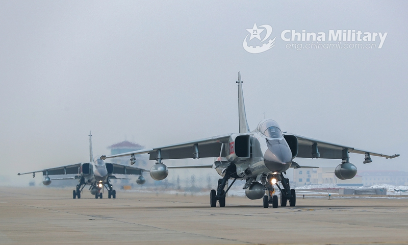 Two JH-7 fighter bombers attached to a naval aviation brigade under the PLA Northern Theater Command taxi on the flightline where the snow blanket has been cleared during a flight training exercise in early January, 2021. (eng.chinamil.com.cn/Photo by Duan Yanbing)