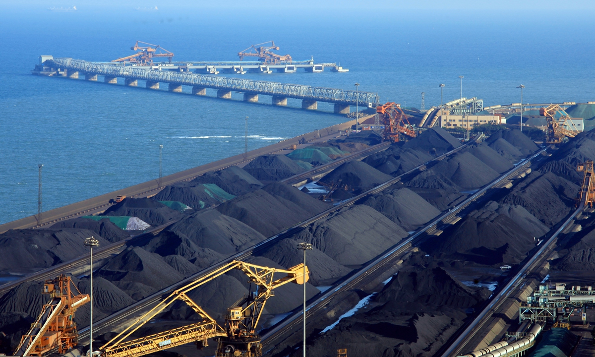 View of piles of coal on a quay in Rizhao, East China's Shandong Province