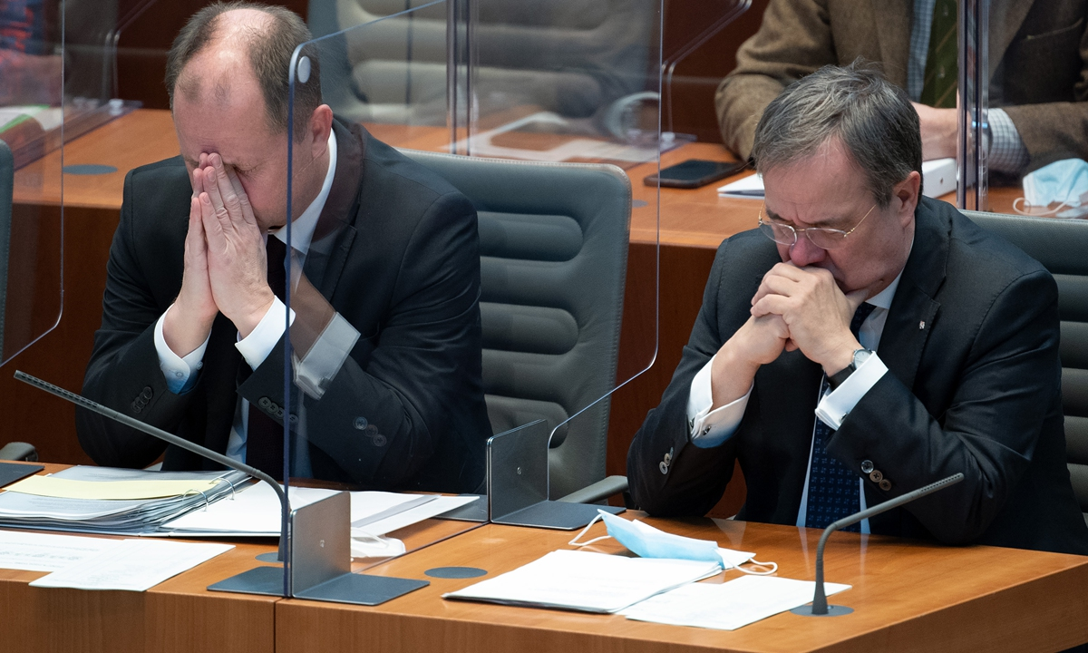 Armin Laschet (right), Minister President of North Rhine-Westphalia, and his deputy Joachim Stamp observe a minute of silence at the state parliament of North Rhine-Westphalia in Duesseldorf, for the victims of Nazism at the 76th anniversary of the liberation of Auschwitz on Wednesday.  Photo: AFP