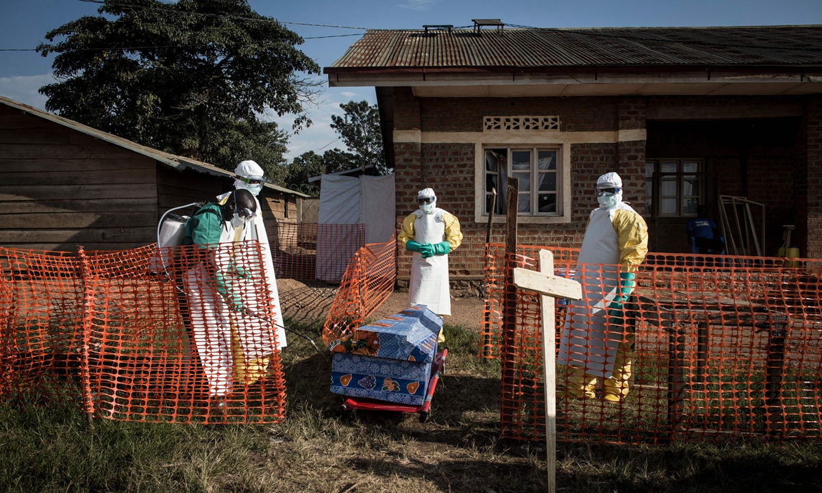 Medical workers disinfect the coffin of a deceased unconfirmed Ebola patient inside an Ebola Treatment Centre run by the Alliance for International Medical Action (ALIMA), in Beni on August 13, 2018. Photo: VCG