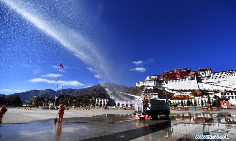 Sanitary workers clean the square of the Potala Palace in Lhasa, capital of southwest China's Tibet Autonomous Region, Feb. 8, 2021. Both the Spring Festival and the Tibetan New Year falls on Feb. 12 this year.Photo:Xinhua