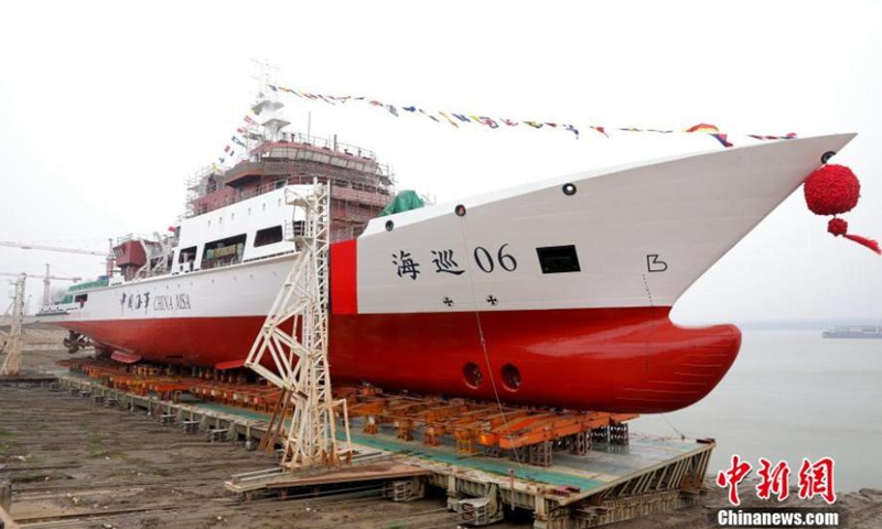 The Haixun 06, a large-scale ocean patrol ship, is launched at a Wuchang Shipbuilding Industry Group Co Ltd shipyard in Wuhan, Central China's Hubei Province, Feb. 8, 2021. The vessel has a designed displacement of 5,560 tons, the first vessel of its size designated to patrol and offer services in the Taiwan Straits.Photo:China News Service