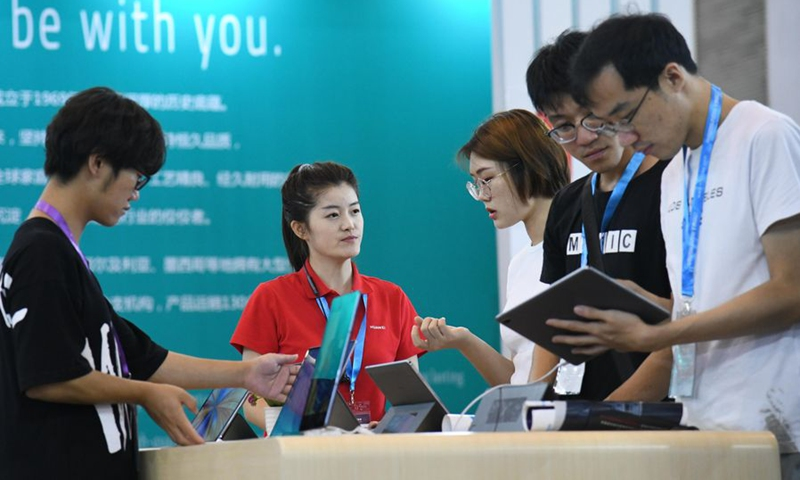 Visitors view tablet devices of Huawei during 2019 China International Consumer Electronics Show (SINOCES) in Qingdao, east China's Shandong Province, July 20, 2019. (Xinhua/Zhang Shanchen)