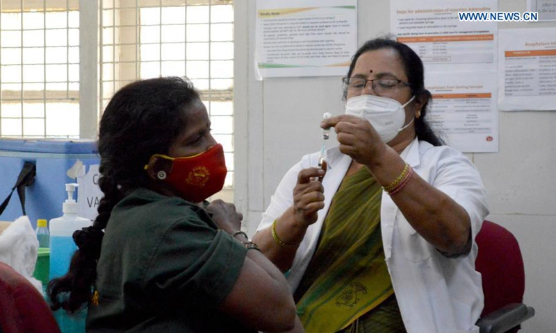 A woman receives a dose of COVID-19 vaccine during the vaccination drive in Bangalore, India, Feb. 12, 2021. (Str/Xinhua)