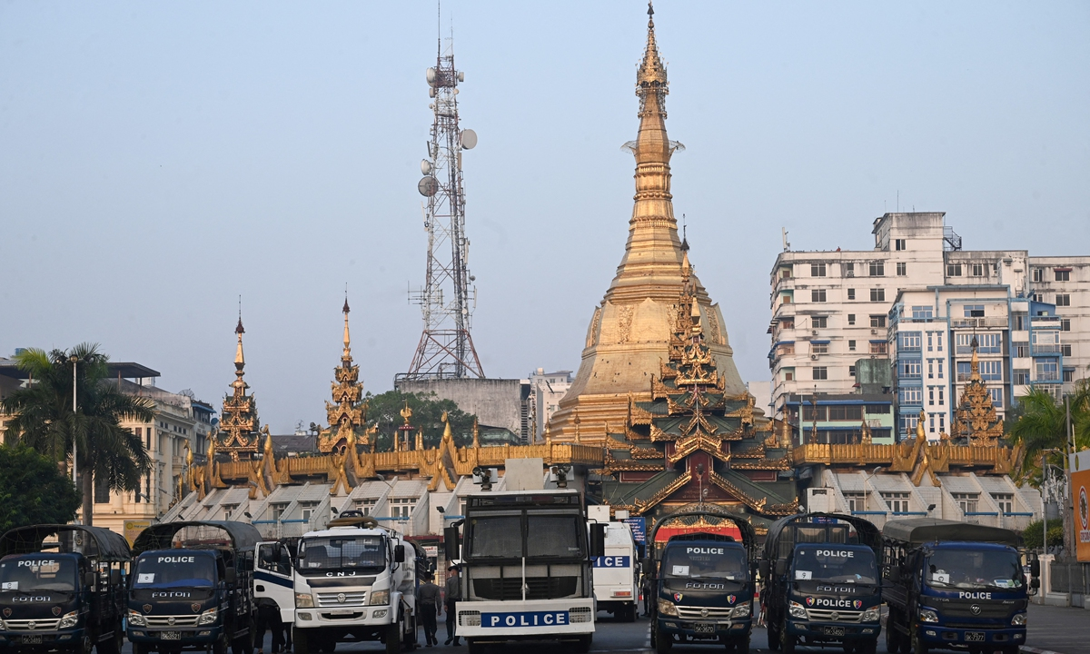 Police vehicles barricade a road outside Sule Pagoda, next to Yangon City Hall in Yangon, Myanmar on February 16. Photo: AFP