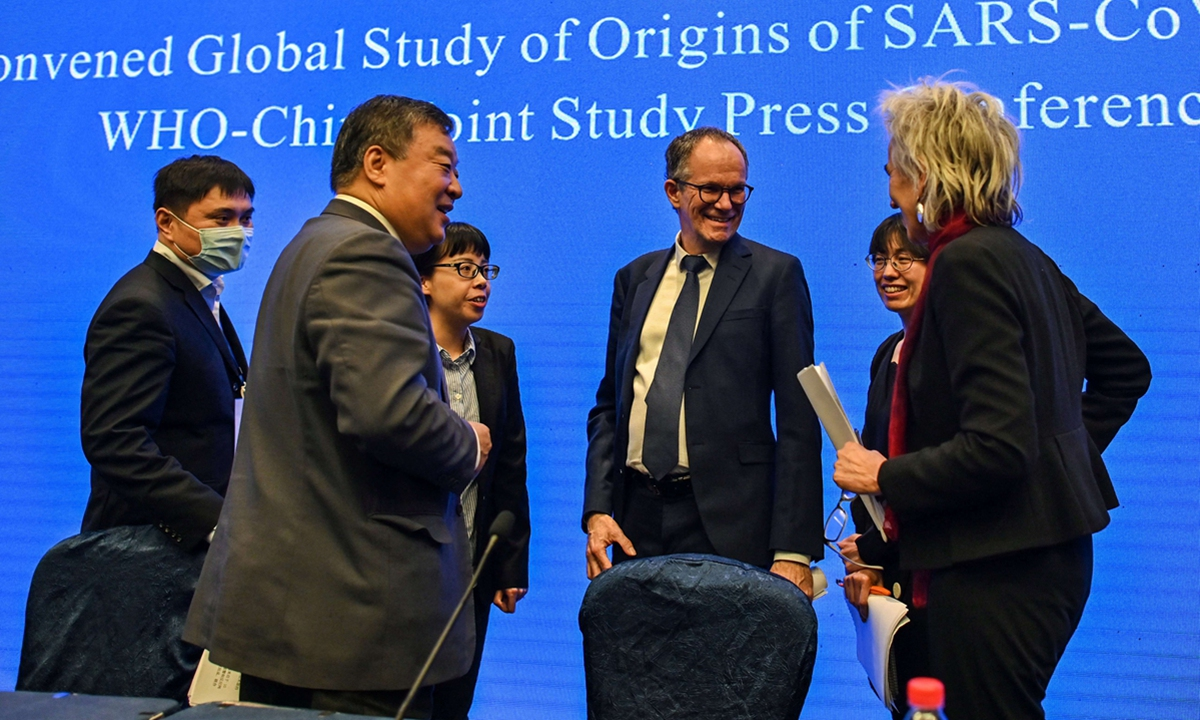 Peter Ben Embarek (center) talks with Liang Wannian (left) and Marion Koopmans (right) after a press conference to wrap up a visit by an international team of experts from the World Health Organization (WHO) in the city of Wuhan, in Central China's Hubei Province on Tuesday. Photo: AFP