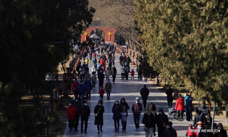 People visit Tiantan (Temple of Heaven) Park in Beijing, capital of China, Feb. 17, 2021. (Xinhua/Ju Huanzong)