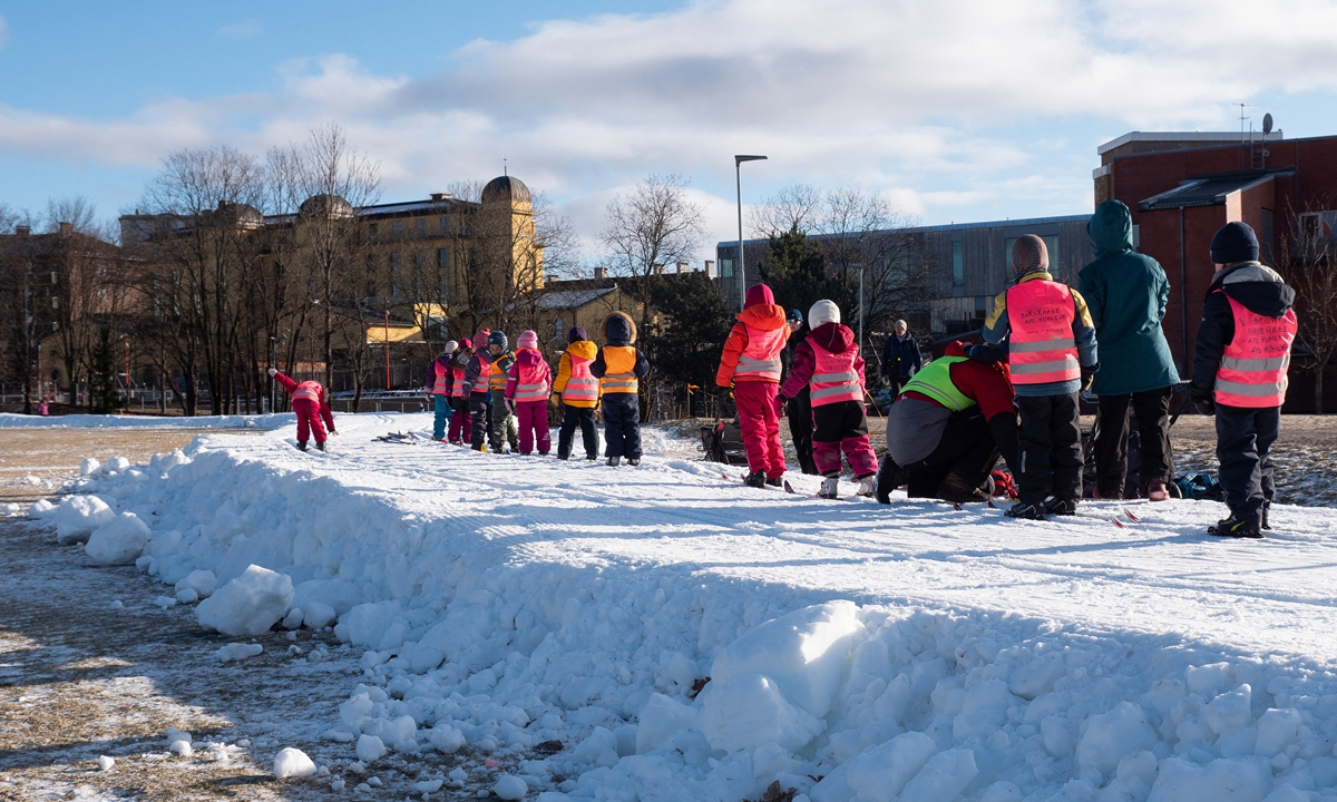 Children ski on trails made of artificial snow in Oslo, Norway on February 10. Photo: AFP