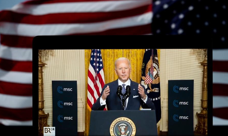 Photo taken in Arlington, Virginia, the United States, on Feb 19, 2021 shows a screen displaying U.S. President Joe Biden speaking in Washington, D.C. during a virtual event with the Munich Security Conference in a video provided by the U.S. State Department. Biden said on Friday that the United States is returning to the transatlantic partnership and will address global challenges like climate change and the COVID-19 pandemic.Photo:Xinhua