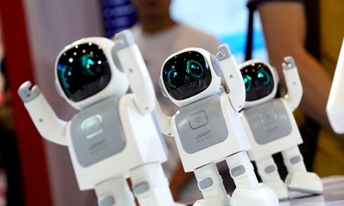 Robots dancing at the first China-ASEAN Artificial Intelligence Summit held in Nanning, capital of South China's Guangxi Zhuang Autonomous Region on Saturday. More than 100 firms displayed cutting-edge intelligent technology and appliances for people's daily lives in the 5G era, and attendees could have a try. Photo: VCG