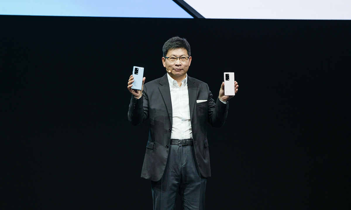 Richard Yu Chengdong holds the newly released Huawei MateX2 series at a launch event on Monday Photo: Courtesy of Huawei