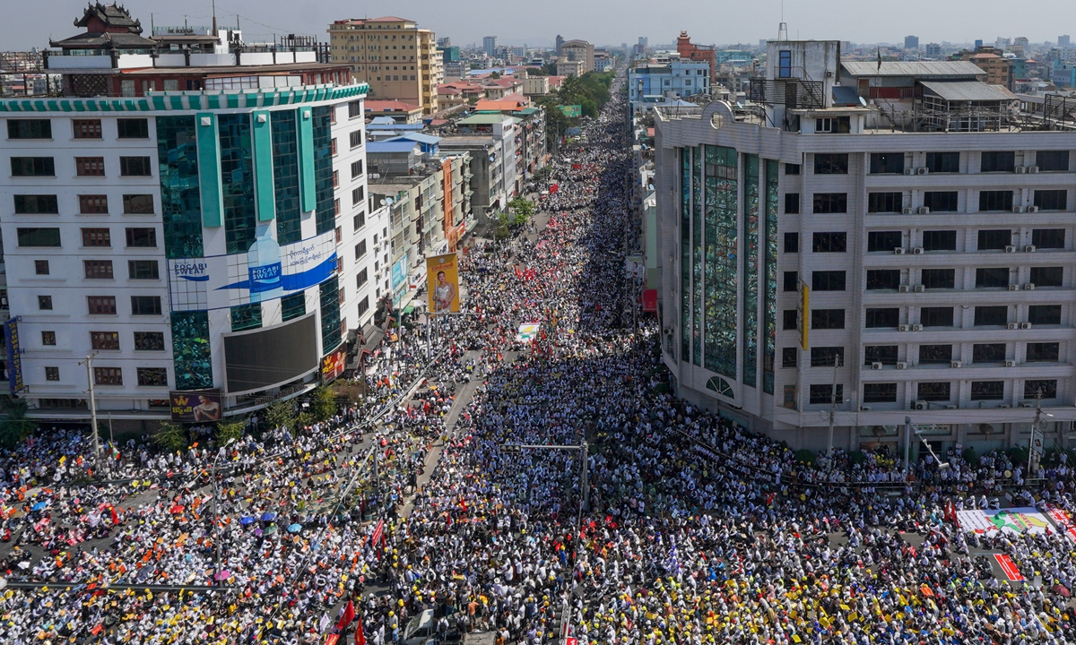 Protesters take part in a demonstration against the military upheaval in Mandalay, Myanmar on Monday. Photo: AFP