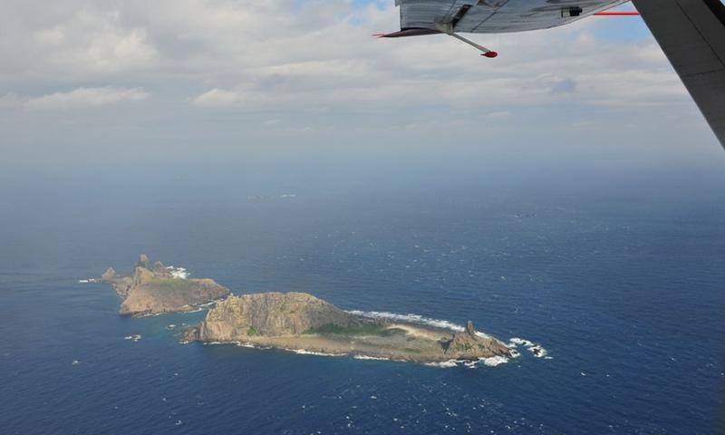 File photo taken on a marine surveillance plane B-3837 shows the Diaoyu Islands and nearby islands.Photo:Xinhua