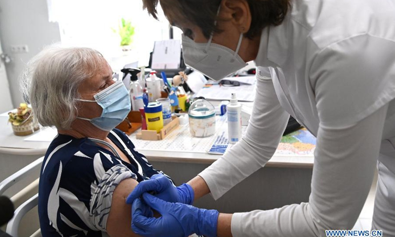 A family doctor administers a dose of the Sinopharm COVID-19 vaccine to a woman in Nagykata, Hungary on Feb. 24, 2021. Hungary has started to administer China's Sinopharm COVID-19 vaccine, as a third wave of the coronavirus pandemic looms, Prime Minister Viktor Orban said Wednesday.(Photo: Xinhua)
