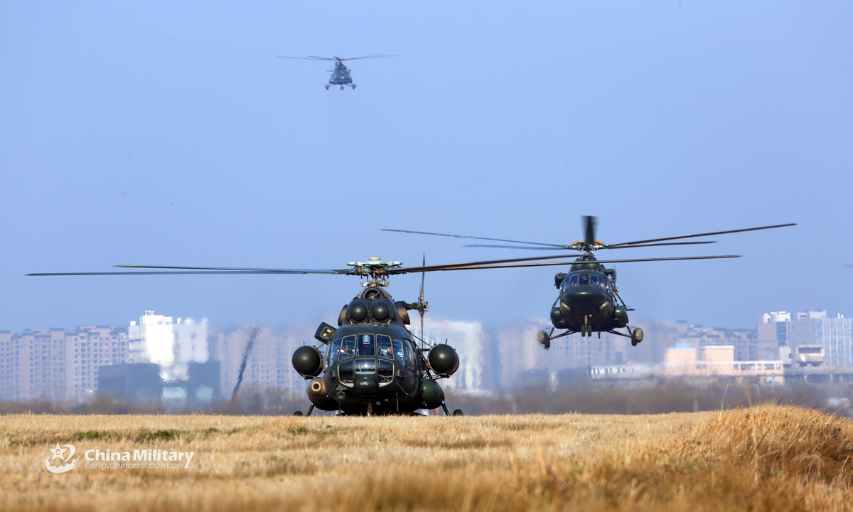 Mi-171 transport helicopters attached to an army aviation brigade under the PLA 72nd Group Army fly in formation during a flight training exercise on Feb 20, 2021.Photo:China Military