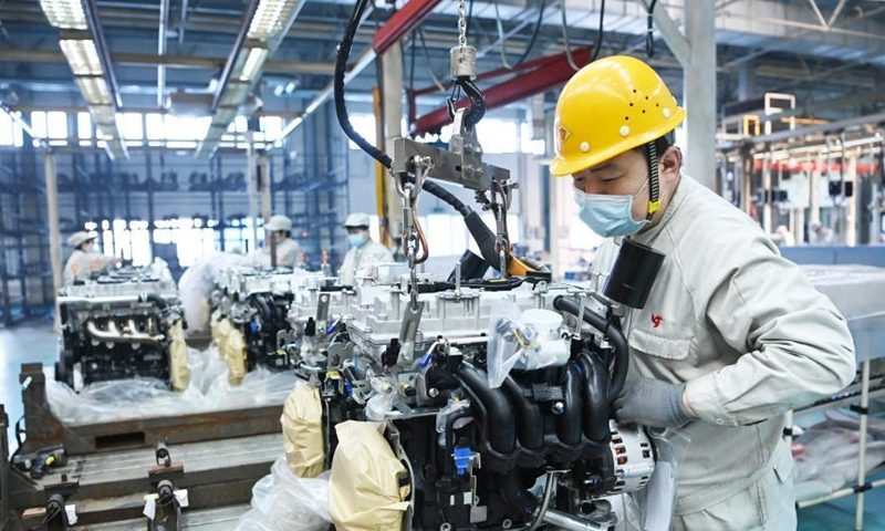 A man works at a workshop of Harbin Dongan Automotive Engine Manufacturing Co., Ltd. in northeast China's Heilongjiang Province, Feb. 25, 2021. In January 2021, the company's product sales and sales revenue increased by 10.79 percent and 18.34 percent year on year respectively. (Xinhua/Wang Jianwei)