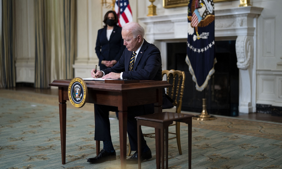 US President Joe Biden signs an Executive Order on the economy on Wednesday in the White House. Photo: AFP