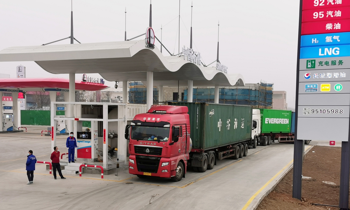 A truck parks inside a new fuel station that provides refills and recharges for a wide variety of energy sources. The station, opened by state-owned oil major Sinopec in Dalian, Northeast China's Liaoning Province Sunday, is first of its kind in the region. It provides hydrogen refilling, electricity charging and natural gas refilling, in addition to gasoline, as China diversifies toward a greener energy mix. Photo: VCG