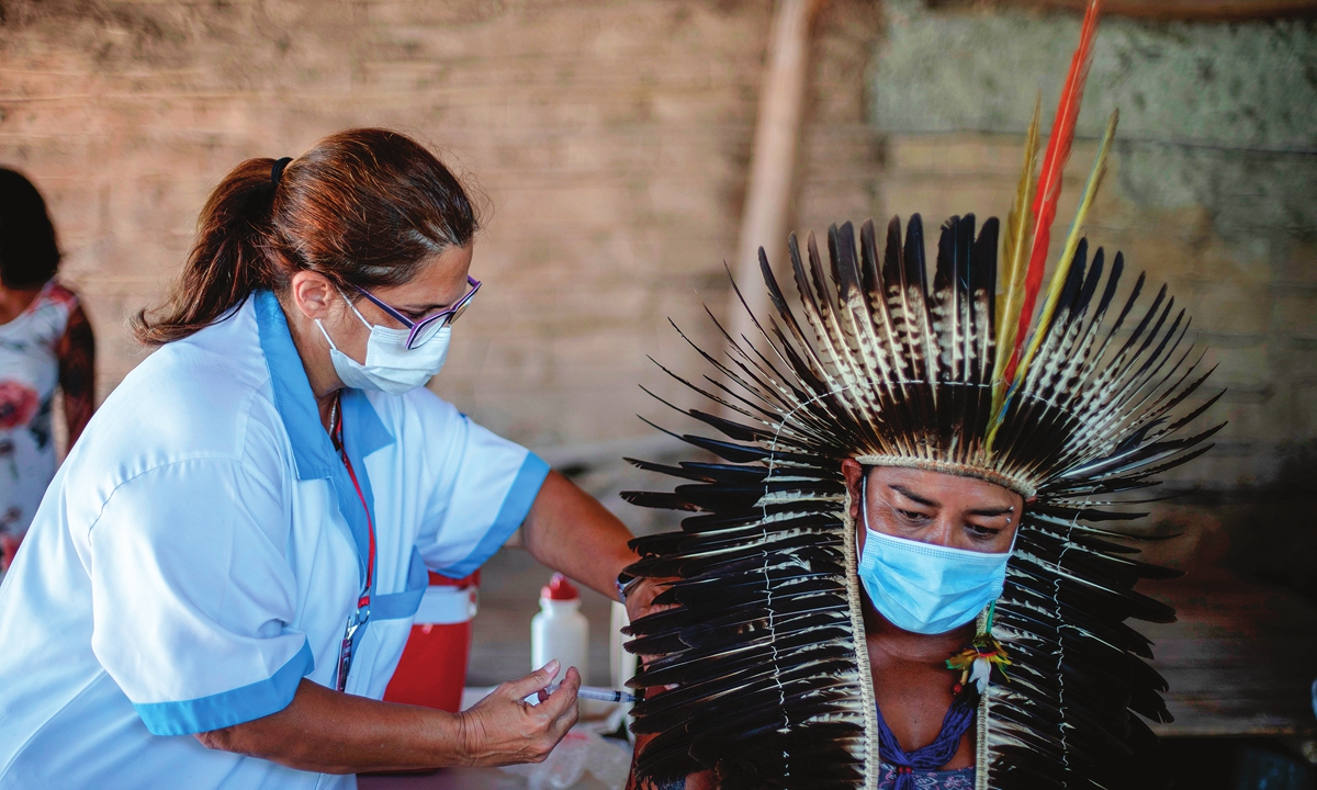 Guarani indigenous chief Jurema Nunes, receives a CoronaVac vaccination shot during a COVID-19 vaccination campaign in Marica, Brazil, on January 20. Photo: VCG