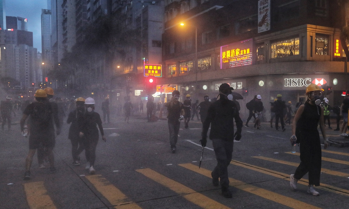 Hong Kong rioters wander on the street during the turmoil on August 11, 2019. They damaged public property and caused a great loss to the Hong Kong society. Photo: AFP
