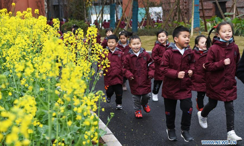 Students run in the campus on their first day of the new semester at a primary school in southwest China's Chongqing, March 1, 2021. Students returned to school for the spring semester on Monday in many parts of China amid coordinated epidemic control efforts.(Photo: Xinhua)