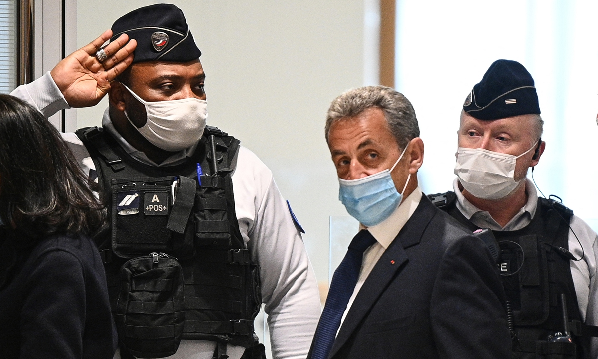 Former French president Nicolas Sarkozy (middle) arrives at the Paris court house to hear the final verdict on Monday. Photo: AFP