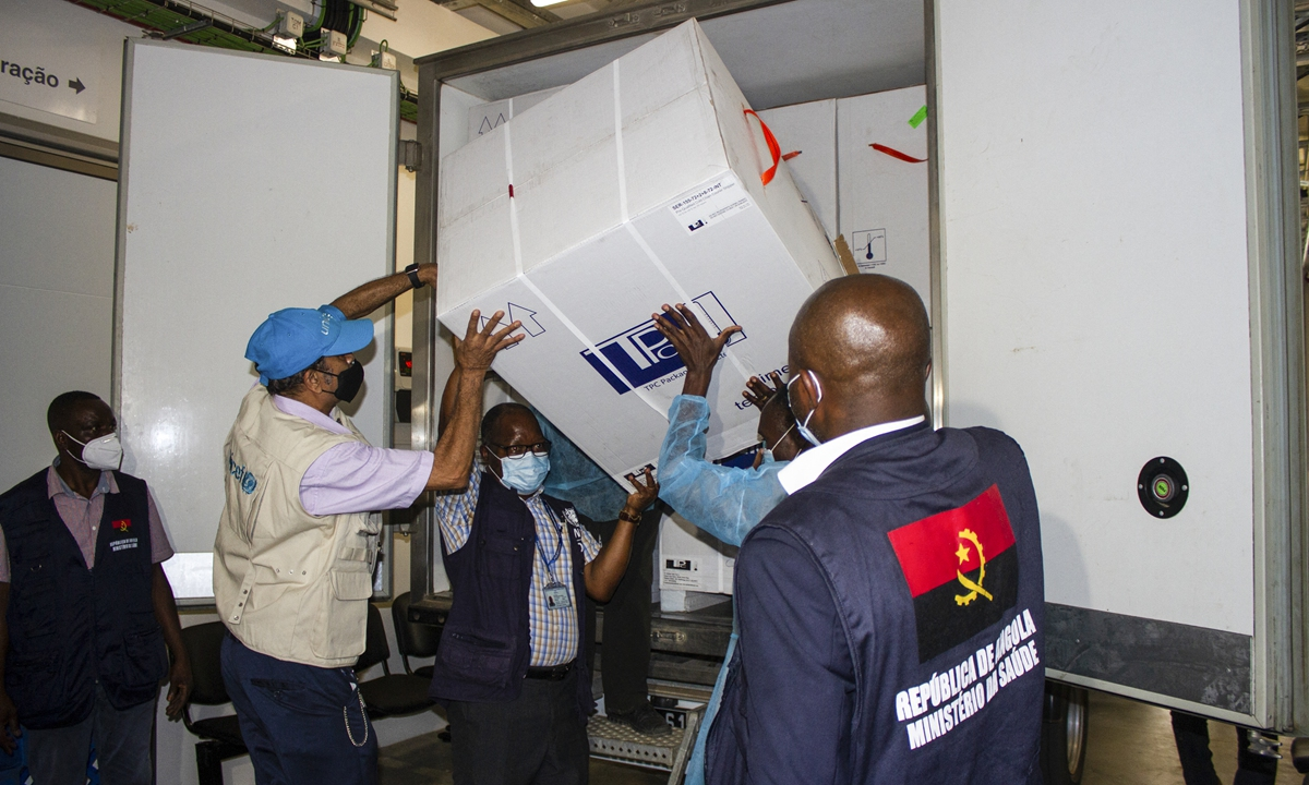 Health professionals unload the first batch of AstraZeneca/Oxford vaccines at the Central Vaccine depot, where they will be stored in Luanda, Angola on Tuesday. Photo: AFP