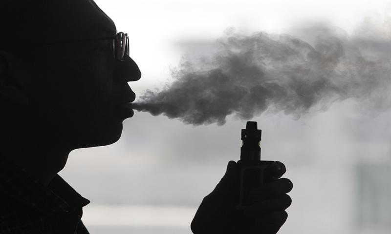 An e-cigarette smoker File photo: VCG