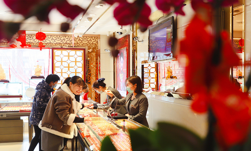 Residents shop at a jewelry store in Qingdao, East China's Shandong Province on March 6, 2021. Photo: VCG