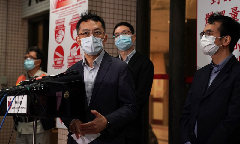 Ronald Lam (3rd R), controller of the Center for Health Protection of Hong Kong, speaks at a press briefing at Queen Elizabeth Hospital on March 3, 2021, Hong Kong, south China.(Photo: Xinhua)